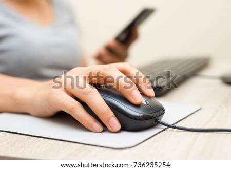 asian women is clicking mouse...