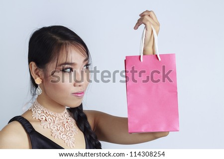 Asian women Looking shopping bag