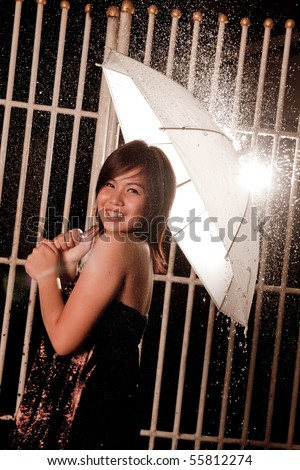 Asian women put steel teeth Happy on the night of rain