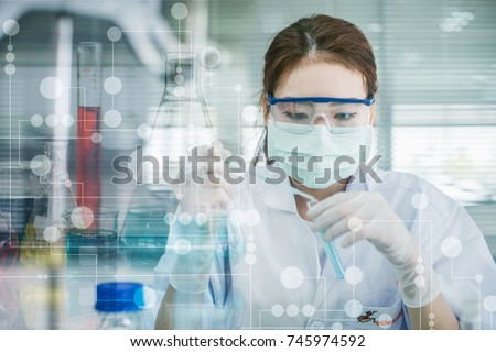 Asian women scientist with test tube making research in clinical laboratory.Science, chemistry, technology, biology and people concept