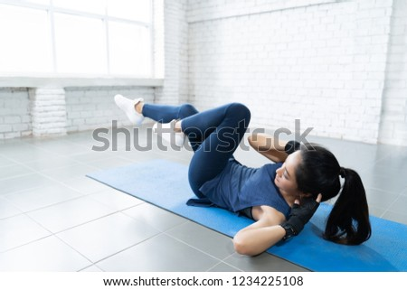 Asian women she is happy to exercise in the house.