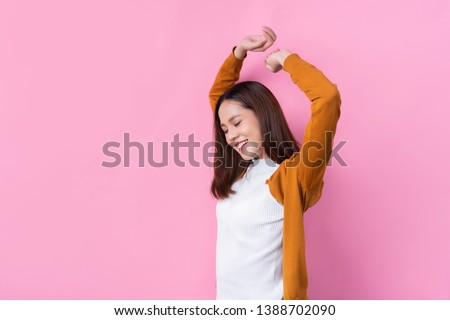 Asian women stretching to relax.studio pink background