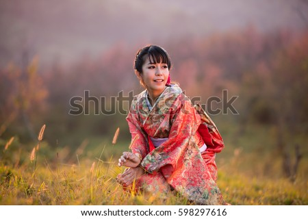 f836fae1dae09 Asian women wearing traditional japanese kimono and red umbrella in the  himalayan sakura garden