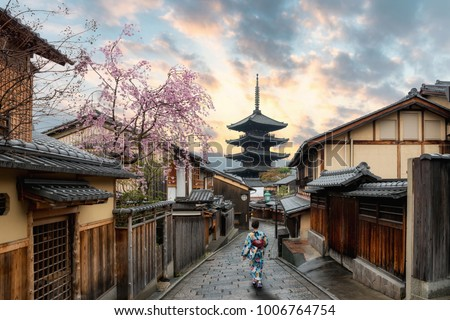 Asian women wearing traditional japanese kimono in Yasaka Pagoda and Sannen Zaka Street with Cherry blossom season in Kyoto, Japan. Woman walking to sight seeing in Japan. #1006764754