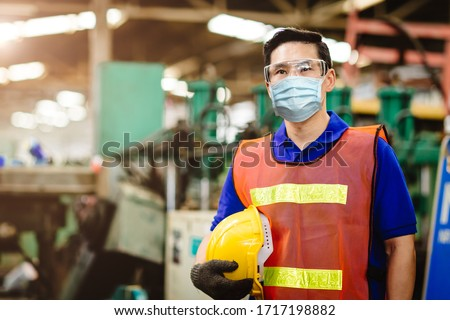 Asian Worker wear disposable face mask for protection Corona Virus Spreading and Smoke dust air pollution filter in factory for healthy labor care.