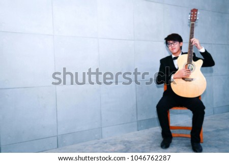 Photo of Asian young blues live guitar classic : Blurry images and blurred backgrounds.