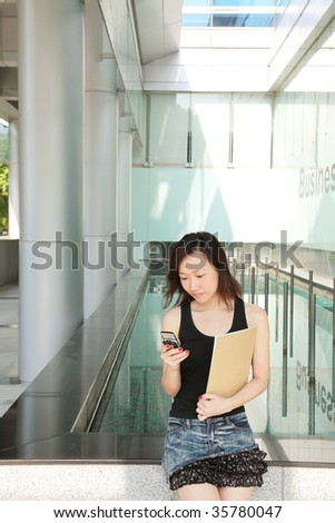 Asian Young Business Woman on the Phone
