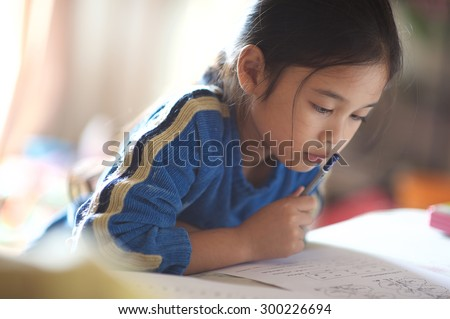 Asian young girl read a book - stock photo
