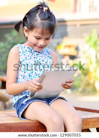 Asian young girl using computer tablet