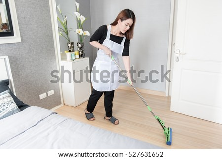 Asian young maid cleaning floor with mop at home, Cleaning service concept