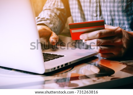 Asian young man holding credit card and typing keyboard laptop for shopping online. Foto stock ©