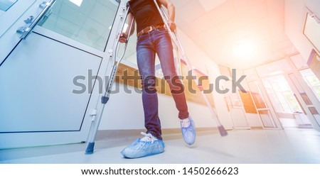 asian Young man on crutches with tree background #1450266623