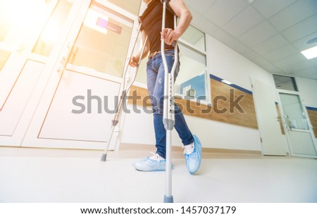 asian Young man on crutches with tree background #1457037179