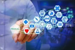 Asian young man pressing medical icon on virtual screen. Healthcare concept.