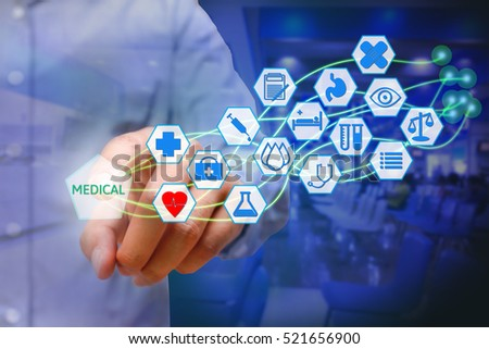 Asian young man pressing medical icon on virtual screen. Healthcare concept.