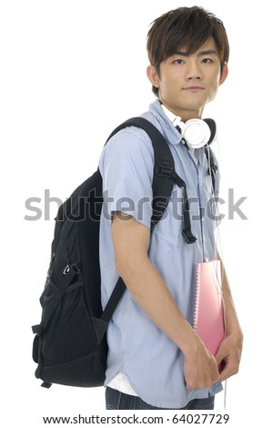 Asian young man standing man with books and bag with headphones.
