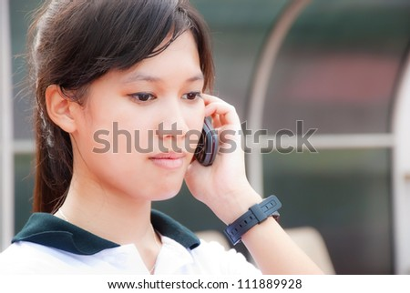 Asian Young smiling woman calling by phone