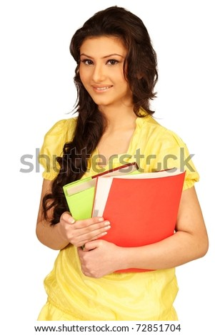 Asian Young teenage girl holding books. Isolated on a white background.