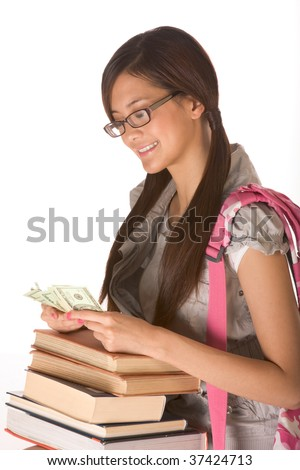 Asian young woman college student with backpack in eyeglasses and pile of books counting money