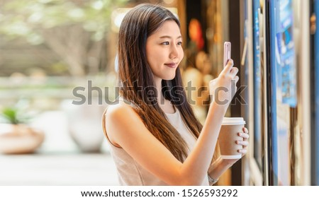 Asian young woman hand using smart mobile phone scanning the movie tickets machine for buy and get the coupon in department store,lifestyle and leisure,entertain and technology scanner concept #1526593292