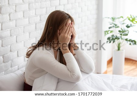 Asian young Woman has a Migraine and headache after wake up in the morning,Healthcare Concept