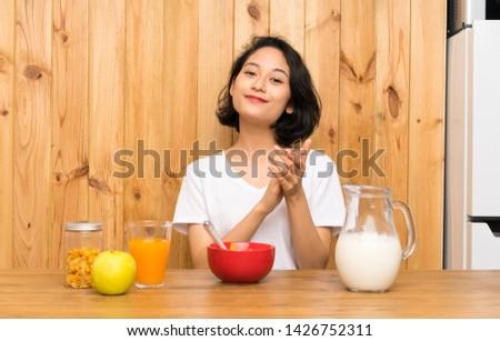 Asian young woman having breakfast milk applauding #1426752311