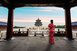 Asian young woman in old traditional Chinese dresses in the Temple of Heaven in Beijing, China. Landscape and culture travel, or historical building and sightseeing concept