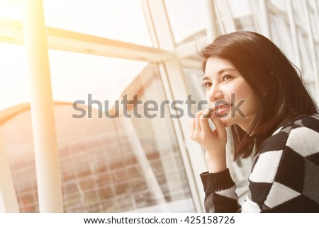 Asian young woman in the airport wait the aircraft #425158726