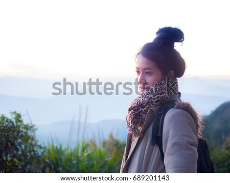 Asian young woman in the morning sunrise