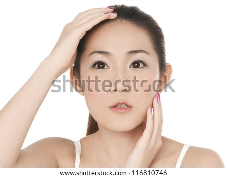 asian young woman smile and hand touch her face for skin care concept