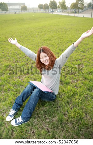 asina reading book on grass