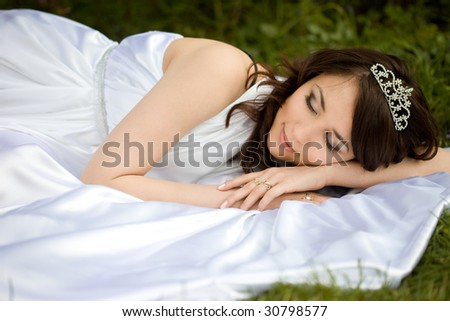 asleep beautiful woman in the fairy-tale forest