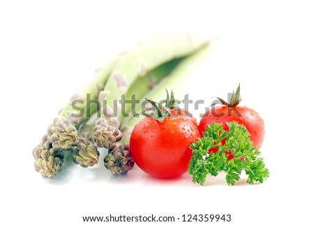 asparagus and tomatoes isolated on a white background