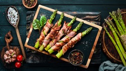 Asparagus baked with bacon and spices. Healthy food. Top view. Free space for your text.
