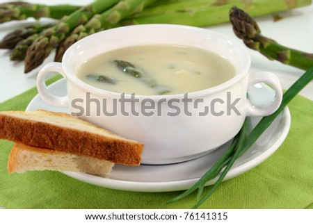 Asparagus cream soup with fresh asparagus, toast and chive Stock photo ©