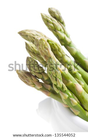 Asparagus in the cup on white background