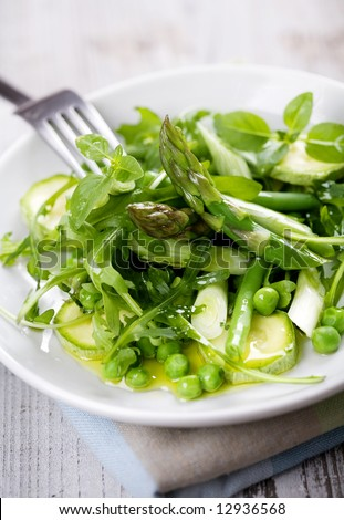 asparagus,rocket,beans,peas,zucchini,spring onions, basil, covered in olive oil