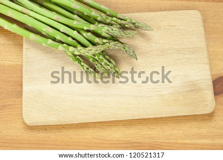 asparagus sprouts on wooden