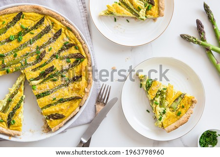 Asparagus tart, vegan quiche homemade pastry, healthy foods. Vegan pie with asparagus on the plate