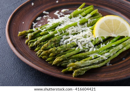 Asparagus with lemons and cheese. Top view #416604421