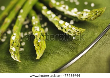 Asparagus with salt on a glass dish