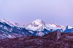 Aspen, Colorado colorful purple pink blue sunrise twilight with Capitol Mt Daly Snowmass mountain peak ridge closeup silhouette in autumn fall season