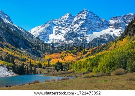 Photo of  Aspen Colorful Autumun under Snow Mountain with Lake