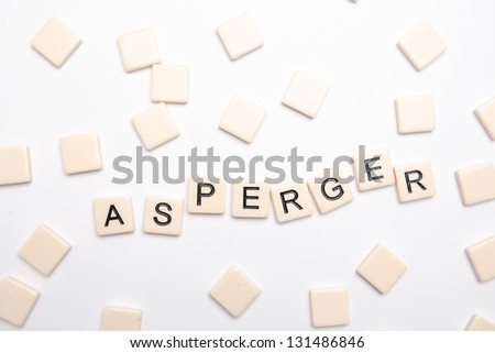 Asperger spelled out in plastic letter pieces on white background