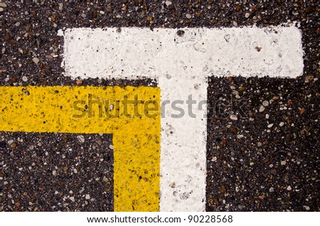 asphalt background with white and yellow lines