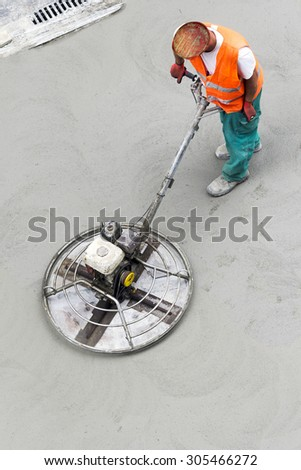 asphalt construction worker to repairing road with compactor manual plate in street city