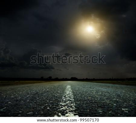 Asphalt country road at sunset