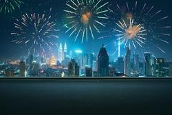 Asphalt empty road side with city skyline and firework sky background . Night scene with firework celebration .