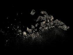 Asphalt explosion on black background