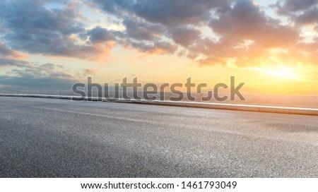 Asphalt highway and beautiful clouds landscape at sunset #1461793049